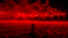 CX02-2016-0042-051 13 February, 2016 Crystal City (Resolute Bay), Nunavut. Students from Canadian Forces School of Search and Rescue Course 49 using AP day-night flares during the Arctic Survival Phase in Crystal City, Nunavut, on 13 February, 2016. Image by Corporal Létourneau PJJ 19 Wing Imaging © 2016, DND-MDN Canada