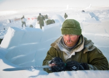 CX02-2016-0042-103 16 February, 2016 Crystal City (Resolute Bay), Nunavut. Corporal Calvin Slute, student of Canadian Forces School of Search and Rescue Course 49, edges with the right angle the wall of his igloo during the Arctic Survival Phase in Crystal City, Nunavut, on 16 February, 2016. Image by Corporal Létourneau PJJ 19 Wing Imaging © 2016, DND-MDN Canada